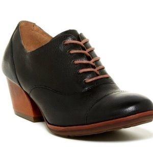 Korkease black leather clogs